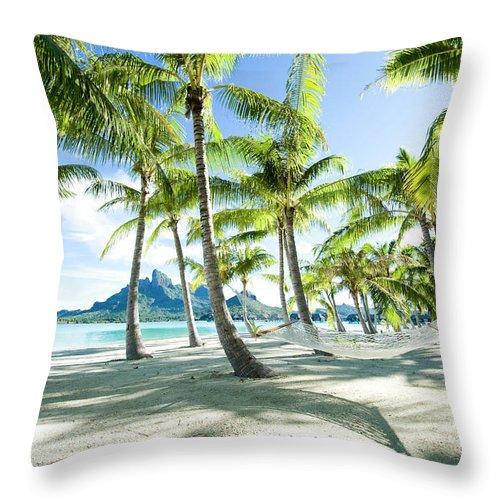 Hanging Throw Pillow featuring the photograph Hammock At Bora Bora, Tahiti by Yusuke Okada/amanaimagesrf