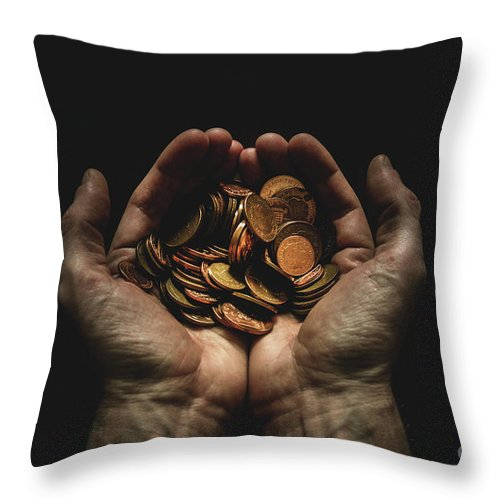 Coin Throw Pillow featuring the photograph Hands Holding Coins Against Black by Andy Kirby