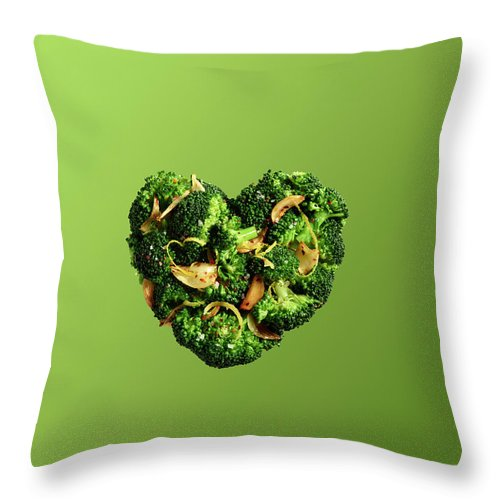 Broccoli Throw Pillow featuring the photograph Heart Shaped Broccoli On Green by Maren Caruso