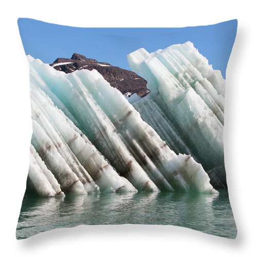 Iceberg Throw Pillow featuring the photograph Iceberg Streaked With Rock Debris by Anna Henly