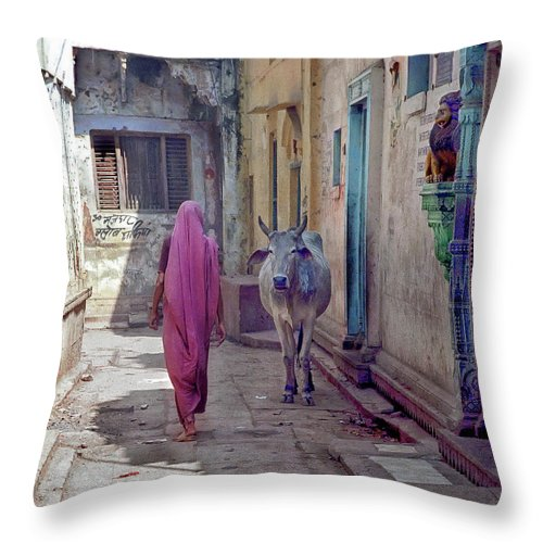 Horned Throw Pillow featuring the photograph India Lady And Cow by Glenn Losack