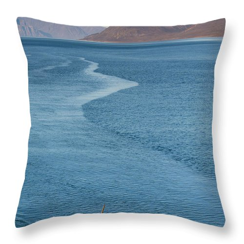 People Throw Pillow featuring the photograph Inuit Man Paddling Traditionally Shaped by Andrew Peacock