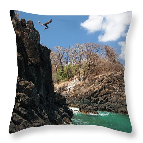 Tranquility Throw Pillow featuring the photograph Jumping by Mauricio M Favero
