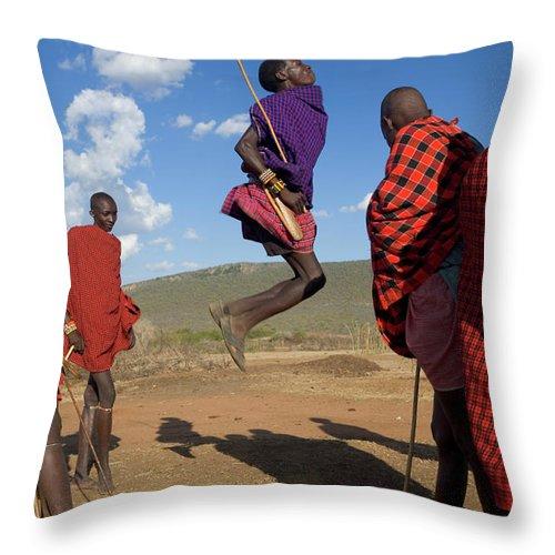 Young Men Throw Pillow featuring the photograph Kenya, Masai Mara, Masai Dancers by Peter Adams