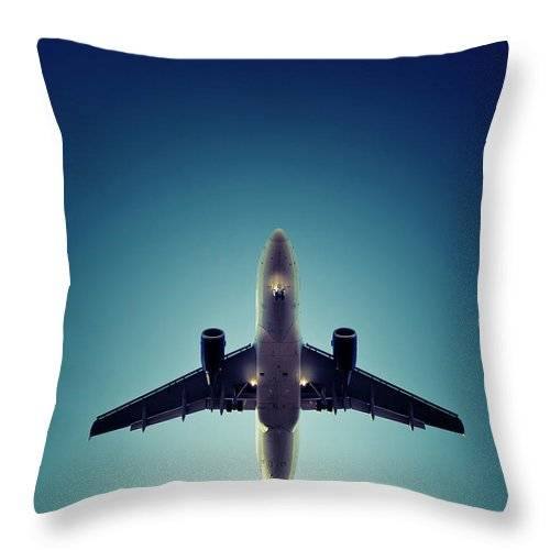 Engine Throw Pillow featuring the photograph Landing Airplane At Dusk by Ollo