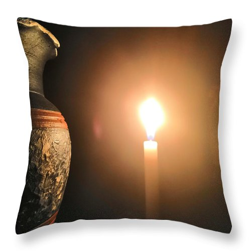 Candle Light Throw Pillow featuring the photograph Light In The Dark by Ian Batanda