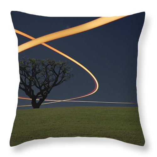 Scenics Throw Pillow featuring the photograph Light Trails Around Tree by Paul Taylor