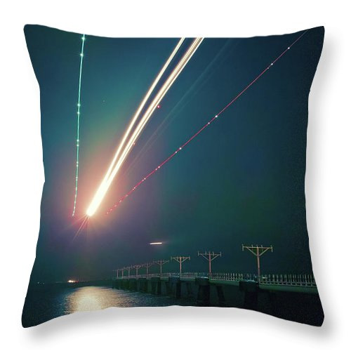 Outdoors Throw Pillow featuring the photograph Light Trails Of Landing Aircraft At by D3sign