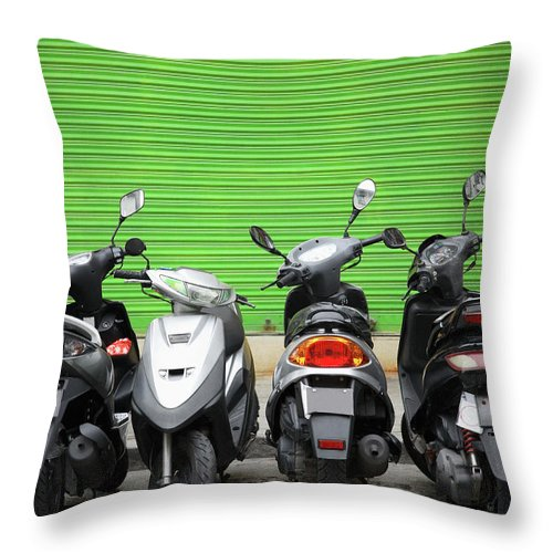 Macao Throw Pillow featuring the photograph Line Of Motorbikes Against Green by Steven Puetzer