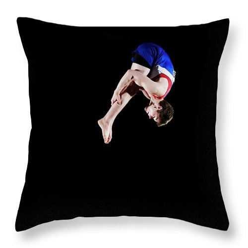 Focus Throw Pillow featuring the photograph Male Gymnast 16-17 Mid Air, Black by Thomas Barwick
