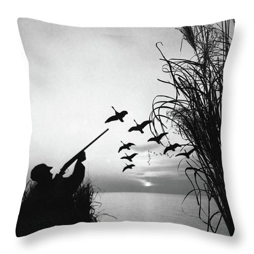 Rifle Throw Pillow featuring the photograph Man Duck-hunting by Stockbyte
