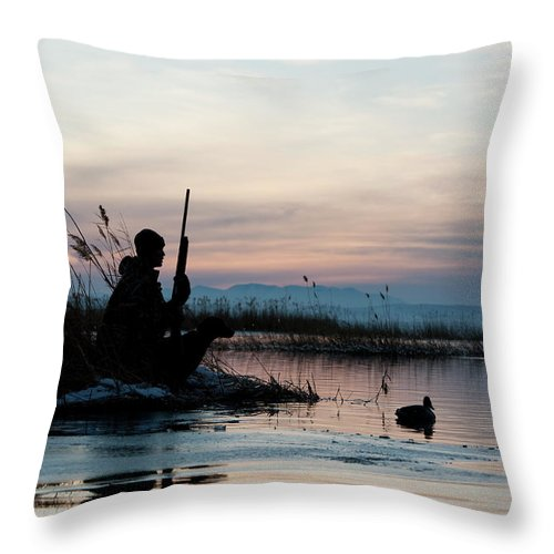 Rifle Throw Pillow featuring the photograph Man Out Hunting by Rubberball Productions