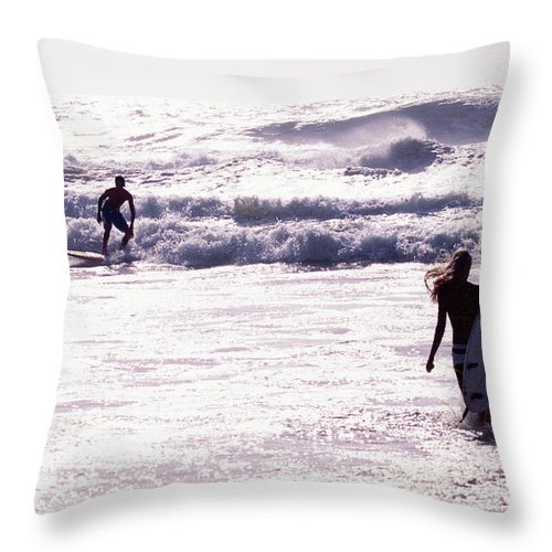 Wind Throw Pillow featuring the photograph Man Surfing On Sea, Woman Walking With by Johner Images