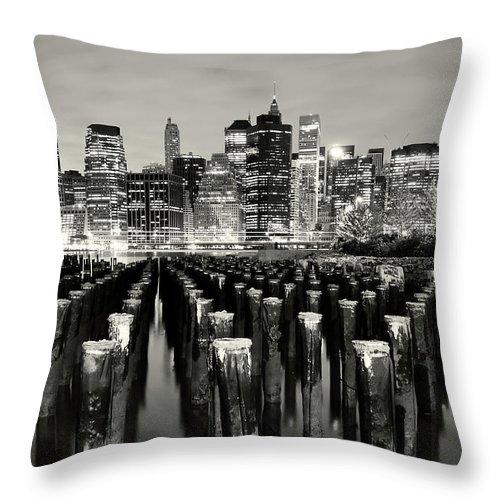 Wooden Post Throw Pillow featuring the photograph Manhattan At Night by Shobeir Ansari
