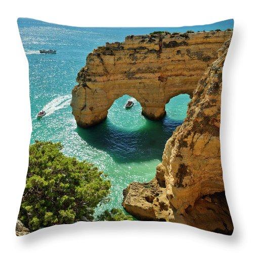 Praia Da Marinha Throw Pillow featuring the photograph Marinha Arches, Portugal by Mikehoward Photography