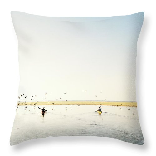 People Throw Pillow featuring the photograph Men Paddling Kayaks To The Beach by Julien Capmeil