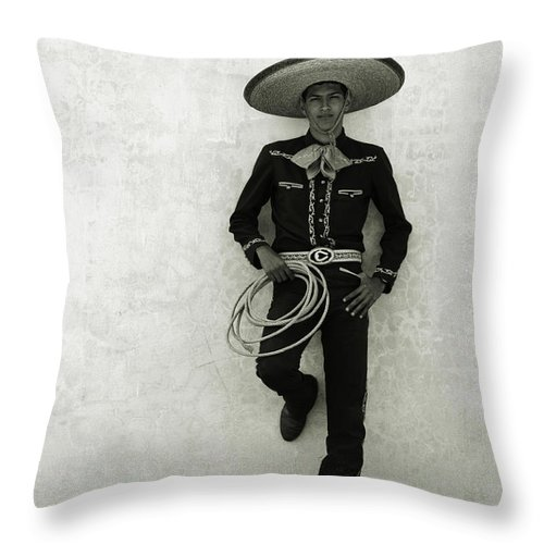 Cool Attitude Throw Pillow featuring the photograph Mexican Cowboy Wearing Hat And Holding by Terry Vine