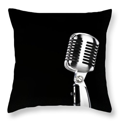 Music Throw Pillow featuring the photograph Microphone Against Black Background by Peter Dazeley