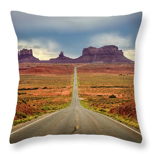 Scenics Throw Pillow featuring the photograph Monument Valley by Posnov
