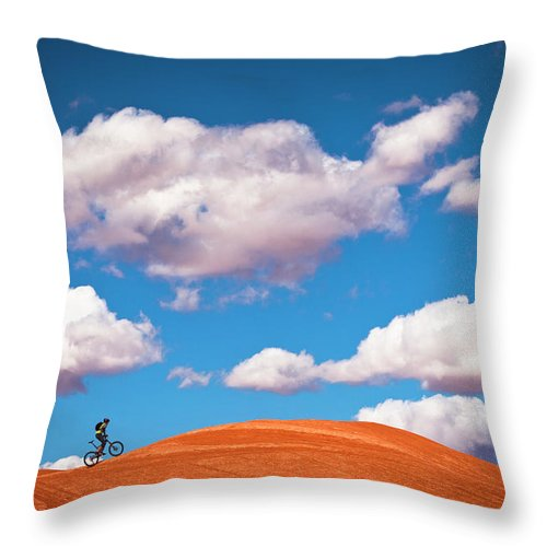 Slickrock Trail Throw Pillow featuring the photograph Mountain Biker Climbing On Slick Rock by Visualcommunications