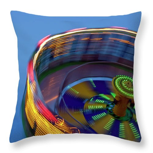 Carousel Throw Pillow featuring the photograph Multicolored Spinning Carnival Ride by By Ken Ilio
