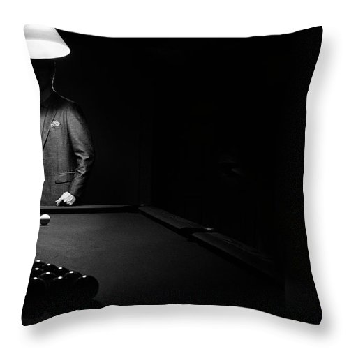 Mature Adult Throw Pillow featuring the photograph Mystery Pool Player Behind Rack Of by Design Pics / Richard Wear