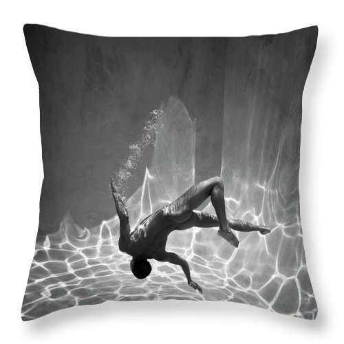 Underwater Throw Pillow featuring the photograph Naked Man Underwater by Ed Freeman