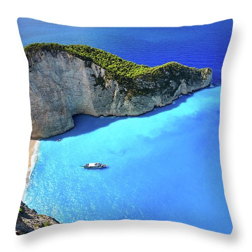 Extreme Terrain Throw Pillow featuring the photograph Navagio Beach, Zakynthos Island, Greece by Rusm