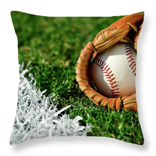 Grass Throw Pillow featuring the photograph New Baseball In Glove Along Foul Line by Cmannphoto