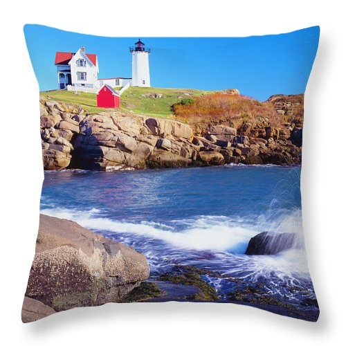 Water's Edge Throw Pillow featuring the photograph Nubble Lighthouse And Coastine Of Maine by Ron thomas