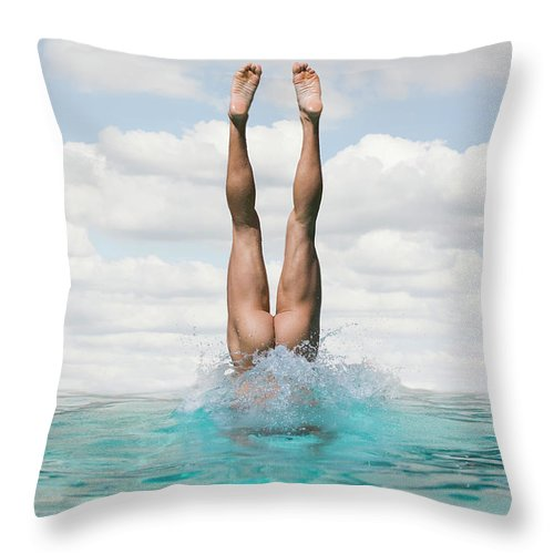 Diving Into Water Throw Pillow featuring the photograph Nude Man Diving by Ed Freeman