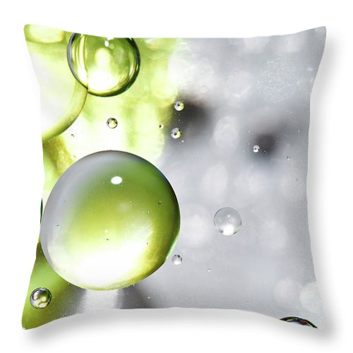 Mixing Throw Pillow featuring the photograph Oil Spheres by Dovate