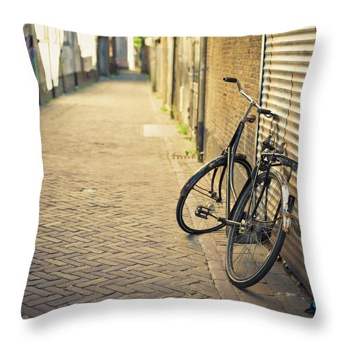 People Throw Pillow featuring the photograph Old Abandoned Bicycle Leaning On The by Cirano83
