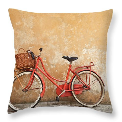 Leaning Throw Pillow featuring the photograph Old Red Bike Against A Yellow Wall In by Romaoslo