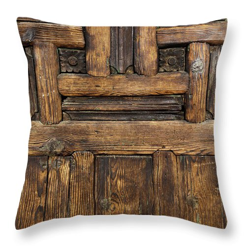 Arch Throw Pillow featuring the photograph Old Wooden Door by Logosstock