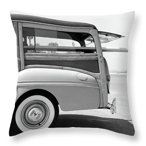 1950-1959 Throw Pillow featuring the photograph Old Woodie Station Wagon With Surfboard by Skodonnell