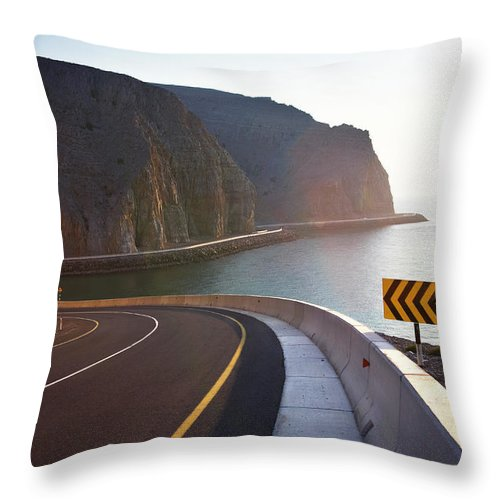 Curve Throw Pillow featuring the photograph Oman, Khasab, Road Round Mountain By by Christian Adams