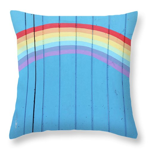 Art Throw Pillow featuring the photograph Painted Rainbow On Wooden Fence by Richard Newstead