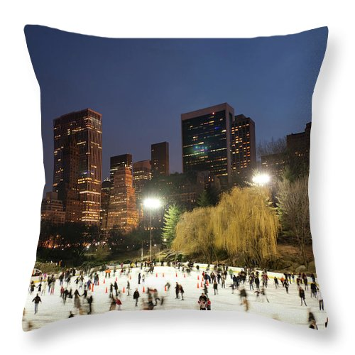 People Throw Pillow featuring the photograph Panorama Of People Ice Skating In by Studiokiet