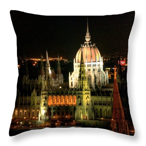 Hungarian Parliament Building Throw Pillow featuring the photograph Parliament Building Lit Up At Night by Roberto Herrero Garcia