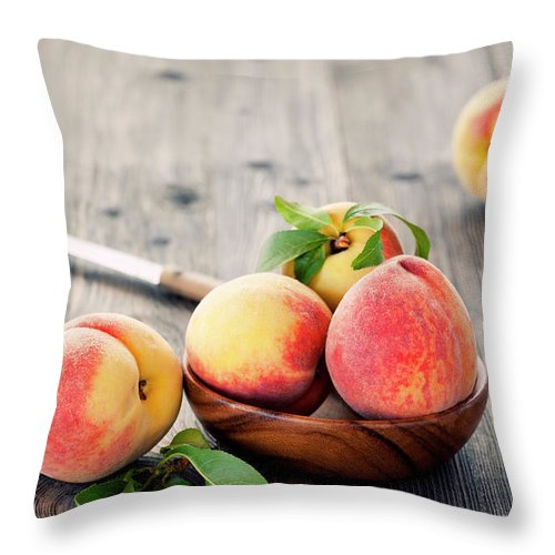 Orange Color Throw Pillow featuring the photograph Peaches by Barcin