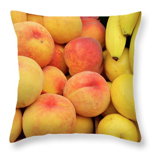 Retail Throw Pillow featuring the photograph Peaches, Lemons And Bananas At Farmers by Travelif
