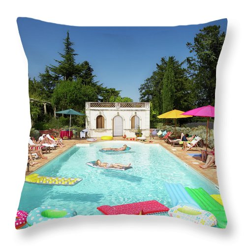 Young Men Throw Pillow featuring the photograph People Enjoying Summer Around The Pool by Ghislain & Marie David De Lossy
