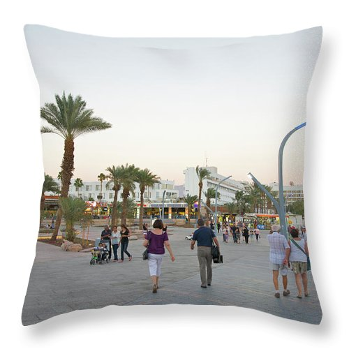 Child Throw Pillow featuring the photograph People Walking On Stone Plaza Near Palm by Barry Winiker