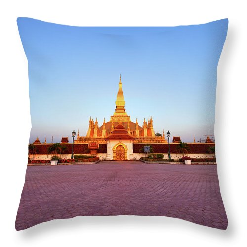 Monument Throw Pillow featuring the photograph Pha That Luang Stupa At Sunset by Fototrav