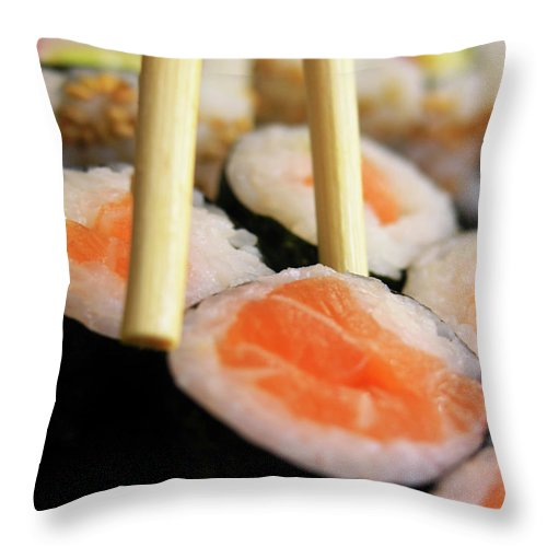 Japanese Food Throw Pillow featuring the photograph Picking Some Sushi by Caracterdesign