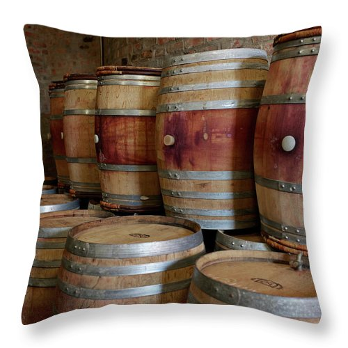 Stellenbosch Throw Pillow featuring the photograph Pile Of Wooden Barrels At Winery by Klaus Vedfelt