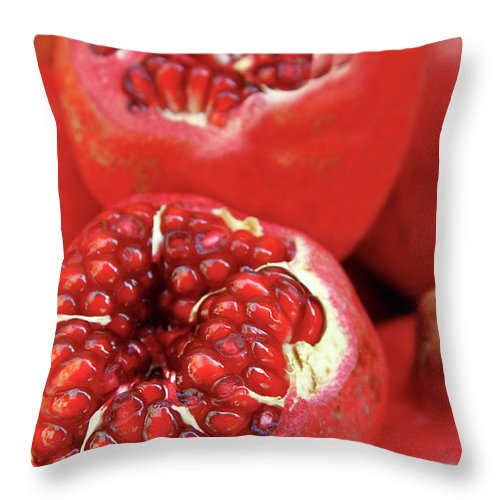 Fermenting Throw Pillow featuring the photograph Pomegranates by Oonal