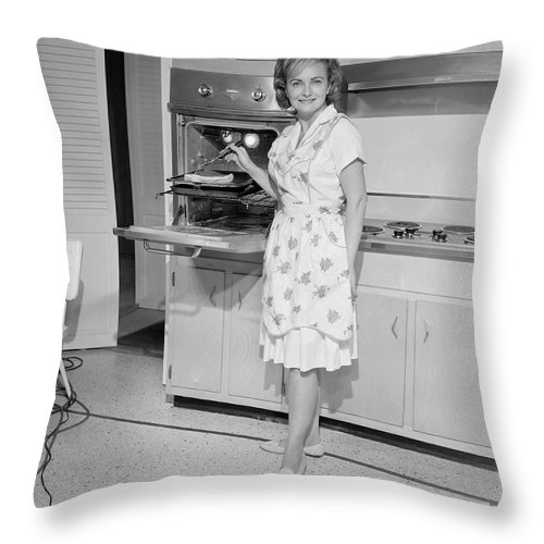 People Throw Pillow featuring the photograph Portrait Of Woman Cooking In Kitchen by George Marks
