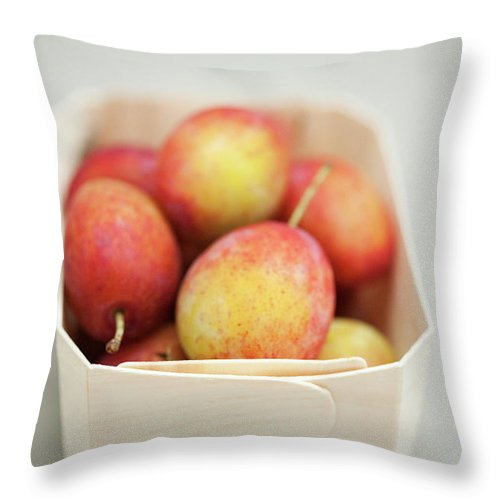 Plum Throw Pillow featuring the photograph Punnet Of Victoria Plums by Diana Miller